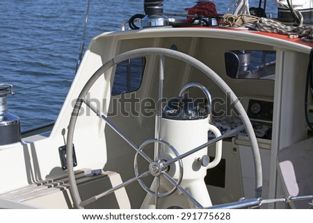 Sailing yacht control wheel and implement witout people. - stock photo