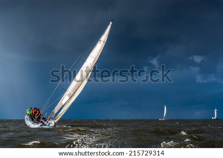 Sailing yacht going before storm - stock photo