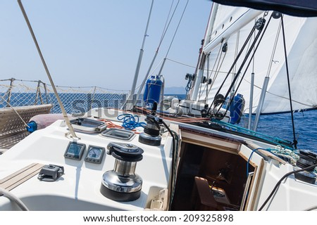 Sailing yacht going fast on full sails. View from the helm. - stock photo