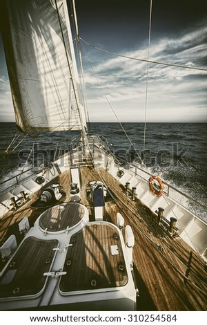 Sailing yacht in a storm.  Toned image and blur. Retro style postcard. Sailing. Yachting. Travel  - stock photo