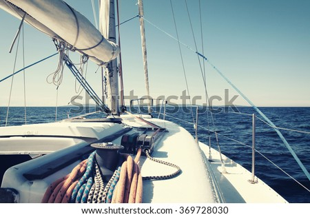 sailing yacht in an open sea, retro style photo - stock photo