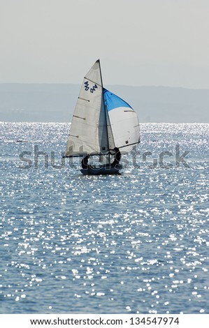 Sailing yacht in Red Sea,  toned photo (420 on a sail - it's yacht's category) - stock photo