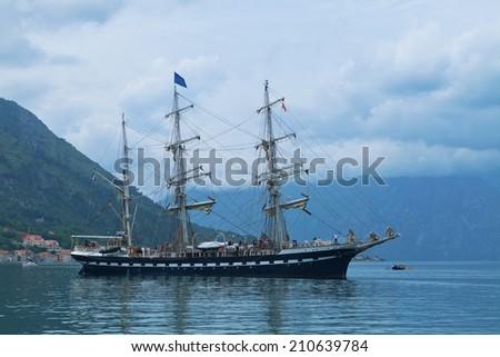 Sailing yacht in the Kotor bay, Montenegro, Adriatic sea - stock photo