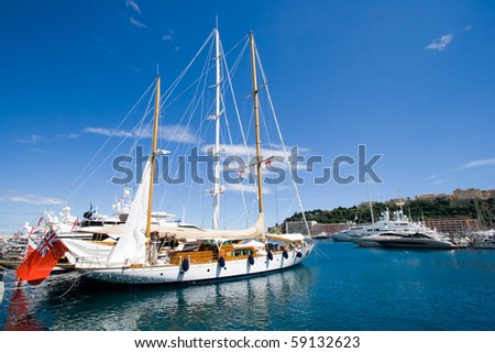 Sailing yacht in the Monte Carlo harbor. Monaco - stock photo