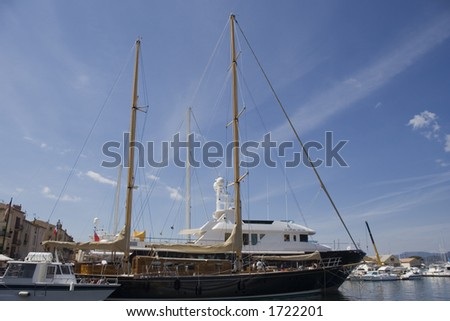 sailing yacht in the port of saint-tropez - french riviera, mediterranean sea - stock photo