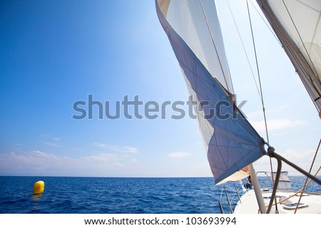 Sailing yacht race at the finish, picture with space for text or logos. - stock photo