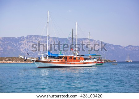Sailing yachts anchored in calm bay. Aegean Sea, Turkey. - stock photo
