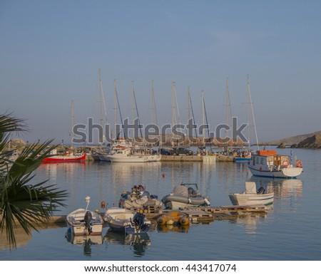 Sailing yachts and fishing boats at marina in Folegandros island, Greece - stock photo