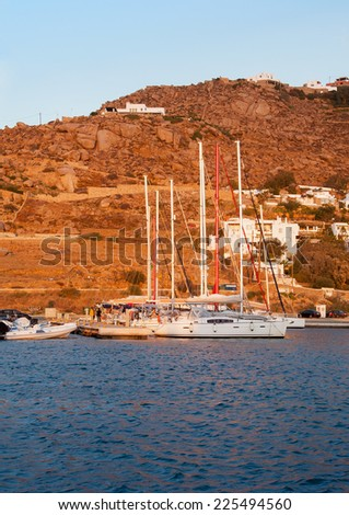 Sailing yachts in the port against the blue sky. Azure Mediterranean Sea, a beautiful island - a good place to relax - stock photo