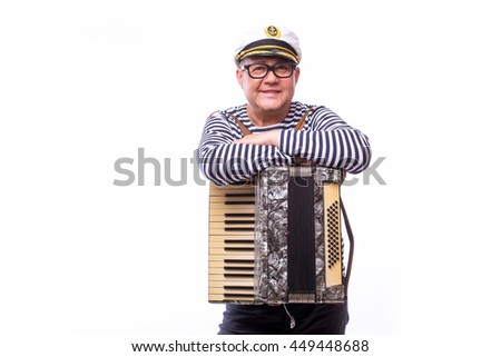 Sailor showman singer with musical instruments drum and accordion on white back - stock photo