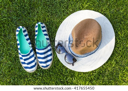 sailor style summer accessories on green grass - stock photo