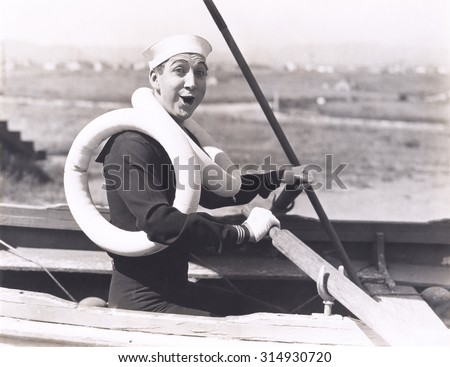 Sailor wearing two life preservers - stock photo