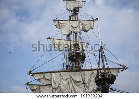 Sails and mast on ancient sailing vessel - stock photo
