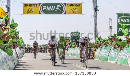 SAINT AOUSTRILLE,FRANCE- JUL 12: Andre Greipel wins against Mark Cavendish and Peter Sagan the intermediate sprint during the stage 13 of Le Tour de France 2013 in Saint-Aoustrille, France. - stock photo