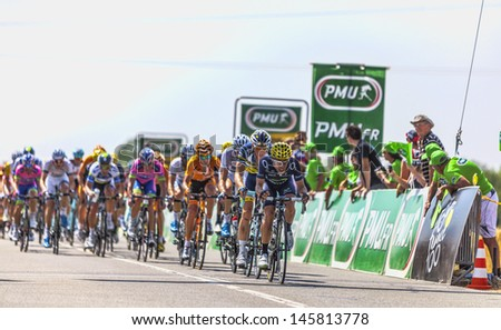 SAINT AOUSTRILLE,FRANCE- JUL 12:  The delayed peloton with Castrovejo on the front at the intermediate sprint line during the stage 13 of Le Tour de France on July 12, 2013 in Saint Aoustrille. - stock photo
