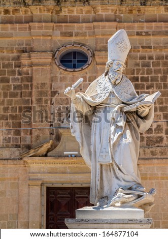 Saint Augustine statue in front of the St Augustine convent in Victoria, Gozo, Malta. - stock photo