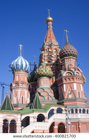 Saint Basil cathedral on the Red Square in Moscow. UNESCO World Heritage Site. Color photo. Blue sky background. - stock photo