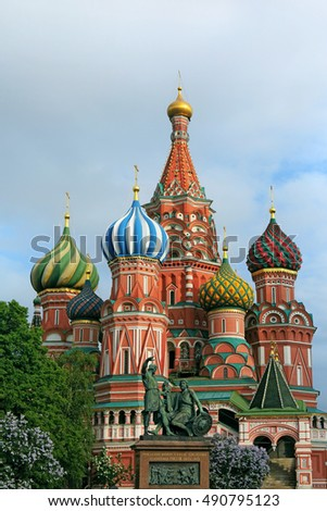 Saint Basil's Cathedral and monument to Minin and Pozharsky on Red Square in spring in Moscow, Russia. Inscription on the monument: Citizen Minin and Prince Pozharsky from grateful Russia, 1818 year