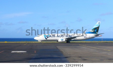 SAINT DENIS, REUNION ISLAND, FRANCE - NOVEMBER 9, 2015: The Boeing 737-300 Air Austral ready for flight on Roland Garros Airport near Indian Ocean coast. Modern aircraft for 128 passengers. - stock photo