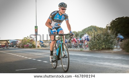 Saint Hilaire de Riez, France - August 10, 2016 : competitors in a night bike race, the 35th Trophy Louis Caiveau - professional cyclist injured during a race after hitting a public person