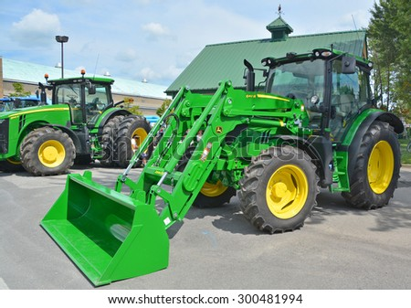 SAINT HYACINTHE QC CANADA JULY 25 2015: TractorJohn Deere 640 R. Deere & Company, the firm founded by John Deere, began to expand its range of equipment to include the tractor business in 1876 - stock photo