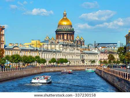 Saint Isaac Cathedral  across Moyka river, St Petersburg, Russia - stock photo