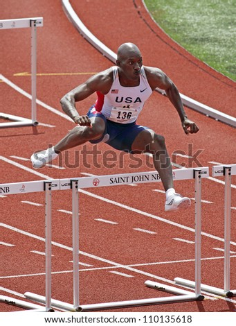 SAINT JOHN, CANADA - AUG 10: Kenneth Eaton of USA runs in the hurdles at the North, Central American & Caribbean Masters Track & Field Championships August 10, 2012 in Saint John, Canada.