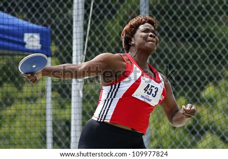 SAINT JOHN, CANADA - AUGUST 10: Trinidad and Tobago's Gwendolyn Smith at the North, Central American & Caribbean Masters Track & Field Championships August 10, 2012 in Saint John, Canada. - stock photo