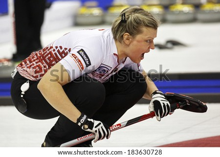 SAINT JOHN, CANADA - March 19: Iluta Linde of Latvia instructs her sweepers at the Ford World Women's Curling Championship March 19, 2014 in Saint John, Canada. - stock photo