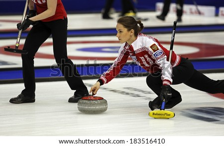 SAINT JOHN, CANADA - March 19: Skip Anna Sidorova of Russia delivers a stone at the Ford World Women's Curling Championship March 19, 2014 in Saint John, Canada. - stock photo