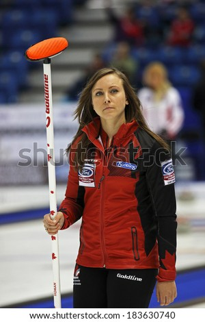 SAINT JOHN, CANADA - March 19: Skip Rachel Homan of Canada after making a successful shot at the Ford World Women's Curling Championship March 19, 2014 in Saint John, Canada. - stock photo