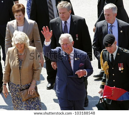 SAINT JOHN, CANADA - MAY 21: Charles, Prince of Wales, and Camilla, Duchess of Cornwall, depart the Marco Polo cruise terminal on May 21, 2012, in Saint John, Canada.