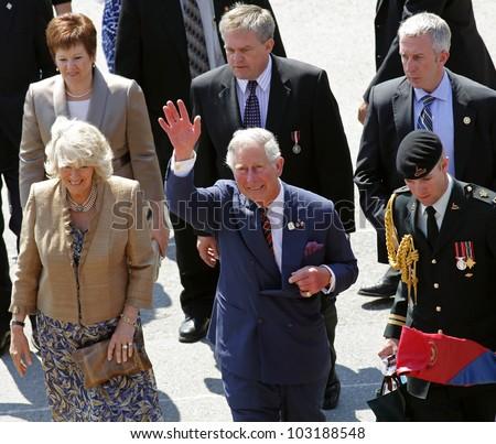 SAINT JOHN, CANADA - MAY 21: Charles, Prince of Wales, and Camilla, Duchess of Cornwall, depart the Marco Polo cruise terminal on May 21, 2012, in Saint John, Canada. - stock photo