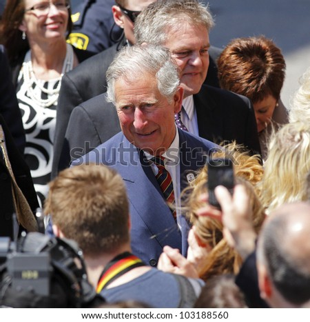 SAINT JOHN, CANADA - MAY 21: Charles, Prince of Wales, greets the public on a walkabout on Prince William Street on May 21, 2012, in Saint John, Canada. - stock photo