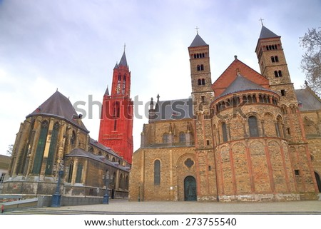 Saint John's Church (left) and Saint Servatius Basilica in overcast day, Maastricht, Holland - stock photo