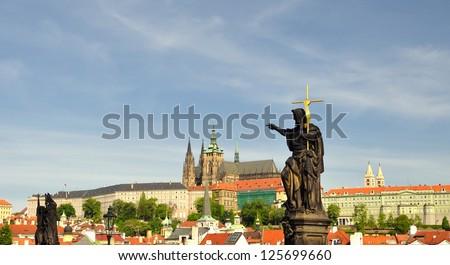 Saint John, the Baptist- statue on the Charles bridge in Prague - stock photo