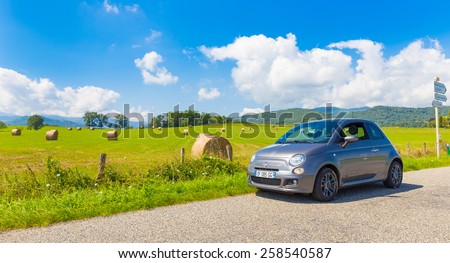 SAINT-LIZIER, FRANCE - JULY 24, 2014: Fiat 500 (Type 312) parked in the French country side in the Midi Pyrenees. The Fiat 500 is a city car built by Italian automaker Fiat since 2007.