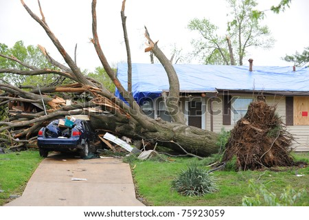 SAINT LOUIS, MISSOURI - APRIL 23: Damaged home with tarp-covered roof after tornadoes hit the Maryland Heights area on Friday April 22, 2011 in Saint Louis, Missouri.