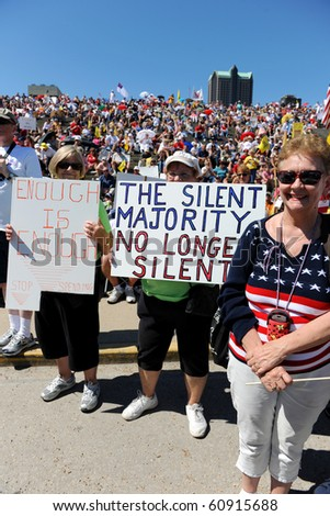SAINT LOUIS, MISSOURI - SEPTEMBER 12: Woman holding signs at rally of the Tea Party Patriots in Downtown Saint Louis under the Arch, on September 12, 2010 - stock photo