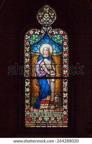 SAINT LOUIS, UNITED STATES - MARCH 11: Stained glass of Mary Magdelene at St Frances De Sales Oratory on March 11, 2015.  St. Frances is the second largest Catholic church in St. Louis.   - stock photo
