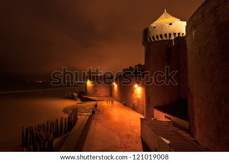 Saint-Malo at night-- is a walled port city in Brittany in northwestern France on the English Channel. It is a sub-prefecture of the Ille-et-Vilaine - stock photo