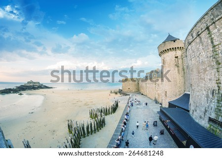 Saint Malo beach and city medieval architecture during Low Tide. Brittany, France, Europe - stock photo