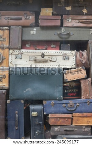 SAINT-MALO, FRANCE - JULY 6, 2011: Ancient suitcases in window display in Saint-Malo, France. Saint-Malo is the main tourist attraction of Brittany in France.