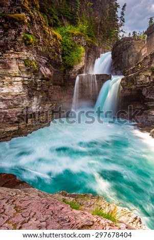 Saint Mary Falls and rushing blue water - stock photo