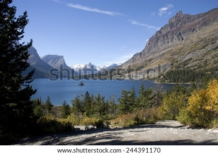 Saint Mary Lake at Glacier National Park is 4 494 feet above sea level and its water temperature rarely exceeds 50 F 10 C . Sept. 2005 photo by Carol Highsmith. - stock photo