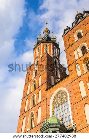Saint Mary's Basilica at the Market square in the Old town of Krakow, Poland - stock photo