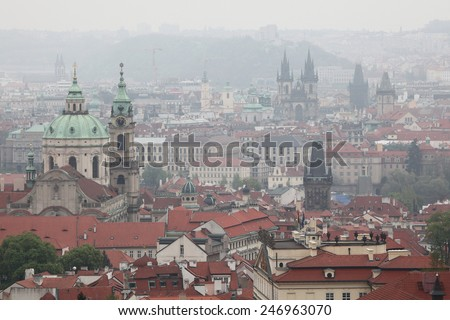 Saint Nicholas Church in Mala Strana and the Tyn Church in Old Town Square viewed from Petrin Hill in Prague, Czech Republic. - stock photo