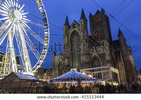 Saint Nicholas' Church with a ferris wheel in the foreground, Ghent, Belgium - stock photo