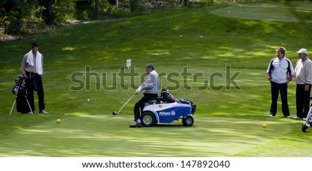 SAINT-OMER, FRANCE. 16-06-2010, A disabled golfer using a special golf buggyatthe European Tour, 14th Open de Saint-Omer, part of the Race to Dubai tournament and played at the AA Saint-Omer Golf Club - stock photo