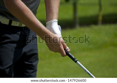 SAINT-OMER, FRANCE. 16-06-2010, A golfer grips a club on the preview day of the European Tour, 14th Open de Saint-Omer, part of the Race to Dubai tournament and played at the AA Saint-Omer Golf Club . - stock photo